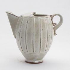 White pitcher by American ceramic artist Pete Scherzer. via the clay studio