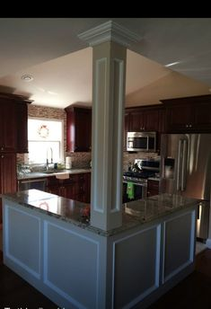 Open floor plan kitchen, knock down walls, l-shaped island, column