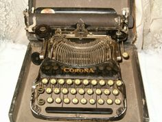 Corona folding/portable typewriter w/case, 1913. Belonged to my grandmother, but now in my family history room.