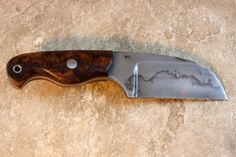 TK Steingass Mountaineer EDC in W-2 and premium Desert Ironwood Burl. Just added it to my collection.    The blade was hollow ground and hand rubbed to 2000 grit then etched to show a vivid hamon. The bright red liners really show up nicely on the tapered tang. This is a versatile everyday carry with a horizontal sheath that can be worn right, left, cross draw, or behind the back.    #knife