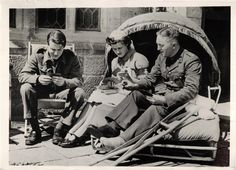 1940- Nurse playing cards with wounded British officers at an English country house that has been turned into a convalescent home for officers.
