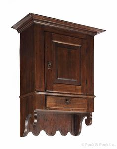 """Pook & Pook.  April 19th & 20th 2013. Lot 603.  Estimated: $4K - $6K. Realized Price: $4977. Pennsylvania Chippendale pine hanging cupboard, ca. 1780, with a molded cornice over a raised panel door, over a single drawer, with scalloped sides and backboard, 35"""" h., 21 1/2"""" w., 10"""" d. Provenance: Dorothy and Eugene Elgin."""