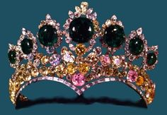 Seven Emeralds Tiara, Iran (1958; made by Harry Winston; emeralds, pink diamonds, yellow diamonds, white diamonds). Made for Empress Farah Pahlavi for her marriage to Shah Mohammad Reza Pahlavi. Now in the National Treasury of Iran.