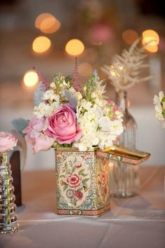 Peony + Hydrangea Centerpiece|Vintage Tea Tins|Blume Photography|See more: http://www.weddingwire.com/wedding-photos/i/centerpieces-pink-centerpiece-rose/i/78935061933e9662-91403074cec7bc02/94e3a420c6b7062f?tags=centerpiece&page=14&cat=flowers&type=search