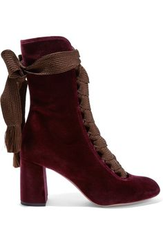 Incorporate the season's decadent velvet trend into day or night looks with Chloé's round-toe boots. This rich burgundy pair has been crafted in Italy with a block heel and chocolate lace-up ties. They look just as chic with denim as they do with voluminous skirts.