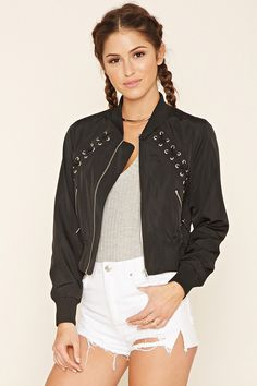 A woven bomber jacket featuring angled crisscross laces along the front, ribbed knit trim, two slanted front pockets with exposed zippers, long sleeves, and an exposed front zipper closure.