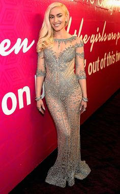 GWEN STEFANI The naked dress isn't going anywhere! Stefani didn't walk the red carpet before the show, but debuted this Falguni & Shane Peacock look during her performance with boyfriend Blake Shelton.