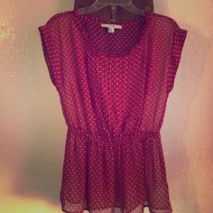 Burgundy and cream polka dot blouse Burgundy and cream polka dot blouse with sinched in waist and accordion detail front.  Cap sleeves. Forever 21 Tops Blouses