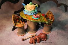 Marlene Brady: Polymer clay teapot, teacup, ladybug, bone & hound dog.  Wooden spools with polymer clay leaves for a tabletop and seats.