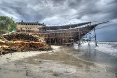 A pinisi boat being built in the famed coastal town of Tanah Biru, in South Sulawesi, Indonesia.  Tanjung Bira