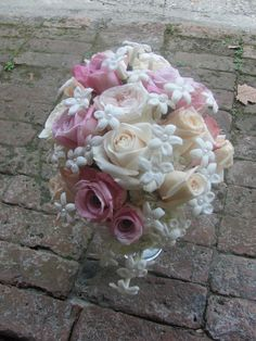 Pear shape bouquet, of Faith, Anna, Vendellas Roses,with stephanotis with pearl centers