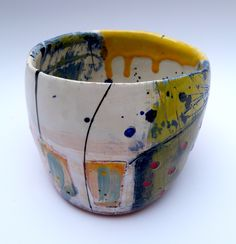 Simple form pot with yellow/blue scratch through stem leading to yellow on flack buds with red decorative dots10cms high x 13cms wide © Linda Styles Ceramics 2014