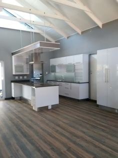 high gloss white laminate Kitchen Cupboards with engineered stone tops