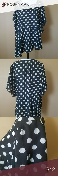 Assymetical polka dot blouse Vintage style black and white polka dot blouse from MY COLLECTION. Great with some red pants and black flats for a chic summer look. Gently used condition looks like new!! NY Collection Tops Blouses