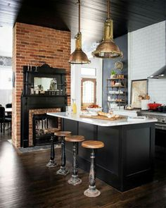 Black & white kitchen with fireplace.