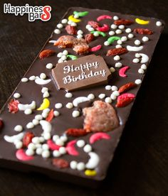 One of our most brilliant looking happiness bars yet is this colourful dark chocolate bar with a Happy Birthday Plaque, moon sprinkles, rice crispies, dried gojiberries and dried strawberries!