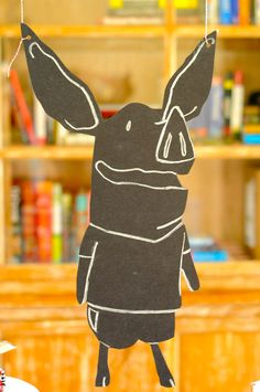 cute cut out of ian drawn with chalk on black paper