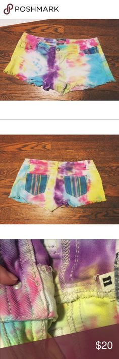 handmade tie dyed shorts 🌞 Tie dyed denim shorts with colorful detailed pockets. I made these shorts myself a few years ago but they still have a lot of life left in them. Tag says 11 which is equivalent to a size 10 Shorts Jean Shorts