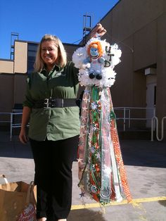 Homecoming mum for Briana Lemos, Director of Student Affairs at UT Dallas. NO...she was NOT going to wear it! She is in charge of the student mum making activity. For the last 4 years I've made her an outrageous mum to hang on the door of her office!
