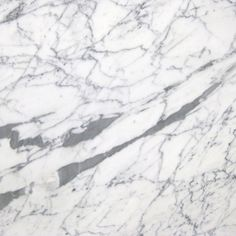 STATUARIETTO. Paper white background with thin black grey veins.  Exquisite marble color available at Knoxville's Stone Interiors. Showroom located at 3900 Middlebrook Pike, Knoxville, TN. www.knoxstoneinte.... FREE Estimates available, call 865-971-5800.
