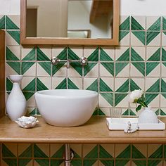 Modern fixtures and hand-painted zig zag tile makes a statement.
