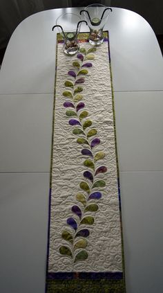 Onother table runner with machine applique decorations.