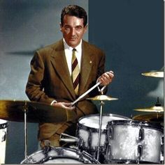 """Eugene Bertram """"Gene"""" Krupa (January 15, 1909 – October 16, 1973)  Krupa was a jazz and big band drummer with Benny Goodman and Tommy   Dorsey. He went against his parents' wishes of him joining the priesthood   to pursue a music career instead. In 1978, Krupa became the first drummer   inducted into the Modern Drummer Hall of Fame."""