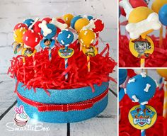Blue, red and yellow Paw Patrol cake pops with chocolate dog bones - Cake Pops - SmartieBox Cake Studio