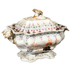 Staffordshire Ironstone Porcelain Covered Soup Tureen - The rectangular bowl raised on a shaped foot flanked by vine handles and fitted with a chrysanthemum final. Overall hand-painted with Imari style foliage in gilt, blue and umber hues. Cover and base marked. – England, late 19th Century - Southall Antiques, San Francisco, CA