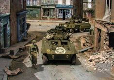 A pair of 'Greyhound' Armored Cars of 'C' Company Armored Reconnaissance Battalion US Armored Division turn from Rue de Vire into Rue de la Forêt Saint-Sever-Calvados Normandy. Normandy Beach, Normandy Ww2, Us Armor, Military Pictures, Ww2 Tanks, Military Diorama, Armored Vehicles, Armored Car, Military History