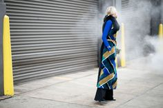 Sofie Valkiers  That long fur J. Mendel patterned vest and those MiH flared jeans are proof that the '70s trend from the runways is already translating to street style.