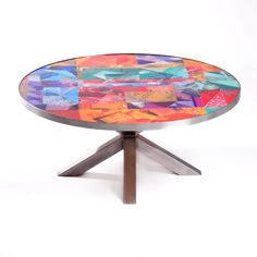 Custom table made with recycled magazines designed by the youth in Artists For Humanity's 3D Design Studio