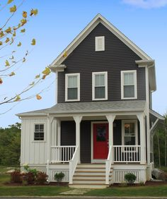 here's charcoal with a red door.  with your light gray house, the charcoal would look good on your shutters and maybe the porch, with a pop of color such as red like this door or another complimentary color.