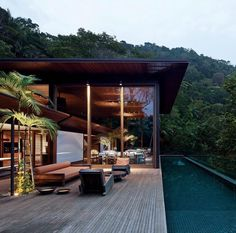 Rainforest Dwelling AMB House designed by Bernandes + Jacobsen Arquitetura Photographed by Leonardo Finotti