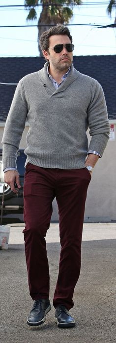 Ben Affleck sports a pull over cardigan and burgundy pants for a perfect casual look.