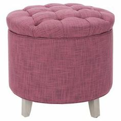 Upholstered storage ottoman with a button-tufted cushion lid.