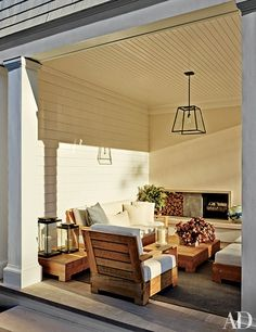 Outdoor furniture (outfitted with a pendant light, seating, tables, and a rug, all by RH.)
