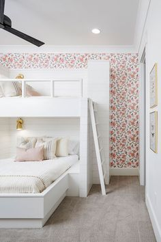 Lovely white and pink girls' bedroom is fitted with shiplap built in bunk-beds dressed in soft white and pink bedding accented with French burlap pillows and lit by antique brass sconces. Bunk Beds For Girls Room, Bunk Bed Rooms, Bunk Beds Built In, Cool Bunk Beds, Kid Beds, White Bunk Beds, Built In Beds For Kids, Custom Bunk Beds, Bunkbeds For Teens