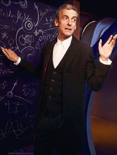 Twelve in front of one of his ubiquitous chalkboards. Will we see what all the equations mean?