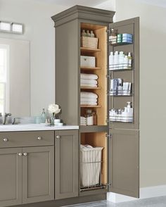 Is your bathroom vanity in need of a glamorous makeover? Clear off your countertop and tidy up the room by stowing away extra towels, the clothes hamper, cosmetics, and toiletries inside thoughtfully designed cabinets. Looking for design inspiration? See how Martha transitions kitchen cabinetry into a custom bath vanity with this video.