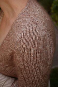 Ravelry: slanted sleeve cardi pattern. Lovely shoulder design.