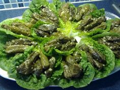 Palestinian stuffed grape leaves - oh, for the love of goodness I hope this recipe is good. Miss the heck out of these things!