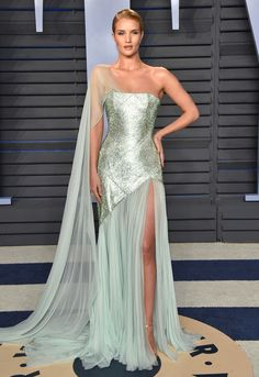 ROSIE HUNTINGTON-WHITELEY wears caped mint Ralph & Russo Couture with Stuart Weitzman heels and Anita Ko jewelry.