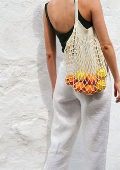 love this casual summer style and the basket with the oranges make it just so extra! what are you most excited about spring/summer Mode Crochet, Hand Crochet, Cotton Crochet, Crochet Market Bag, Net Bag, Summer Aesthetic, Tomboy Aesthetic, Aesthetic Bags, Orange Aesthetic