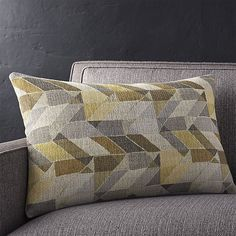 Metallic threads enliven this modern, geometric pillow with a hint of shine, while interwoven yarns create a tweedy effect. Our decorative pillows include your choice of a plush feather-down or lofty down-alternative insert at no extra cost.