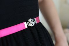 Elastic fuchsia waist belt featuring silver or 24K gold plated brass filigree element center, and closes in the back through a delicate Silver or