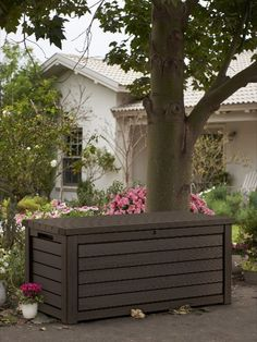 A superb outdoor storage solution for all year round.  With heavy-duty waterproof resin. It is designed to stand in your garden and protect your cushions, tools, barbecue equipment and more all year round. This garden storage box can be also used for extra seating suitable for two people. Available in two colours. Garden Furniture, Outdoor Furniture, Outdoor Decor, Outdoor Storage Boxes, Brown Wood, Dark Brown, Artificial Plants, Natural Looks, Norfolk