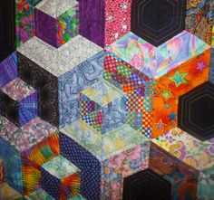 Honeycomb tumbling blocks quilt by Jan Hassard (UK).  Quilt Retreat.