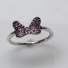 New Pandora Minnie Mouse Ring UPick the size This is a Brand New Authentic Pandora Ring.  Comes in Pandora Pouches or Paper Folding box.   New in sizes 6, 6.5,7, 7.5, 8, 8.5 9   Visit my Store with over 700 Pandora Items.   All Hallmarked and properly stamped.  If any questions or concerns please drop me a note.   Hard Box Sold Separately $3.00  Thanks and Happy Shopping.   Oh, if you need anything special just let me know and I will do my best to get you what you want. Pandora Jewelry Rings