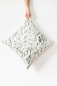 """Organic black flecks adorn this modern pillow cover bringing an understated pattern to your sofa styling.  My original """"Speckled"""" design is printed with eco-friendly ink onto the linen/cotton blend front, and is finished with a natural cotton canvas on the back.  Click to buy."""